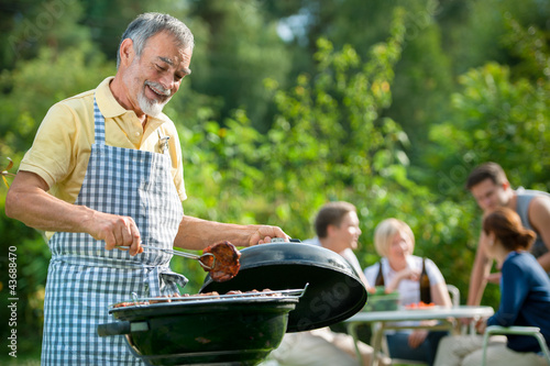 Family having a barbecue party - 43688470