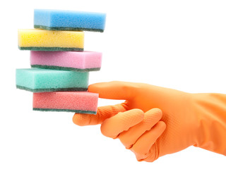 hand in protective glove with dish washing sponge on white