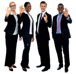 Successful corporate team showing ok symbol
