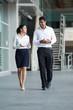 Indian Businessman & woman walking.