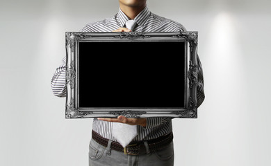 holding a frame
