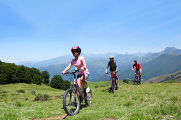 Family riding bikes in the mountains