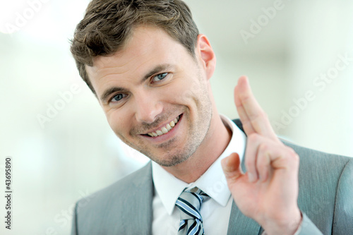 Portrait of cheerful businessman with successful and happy look