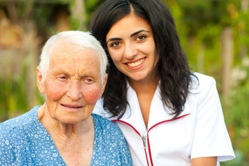 Doctor and elderly woman outdoors