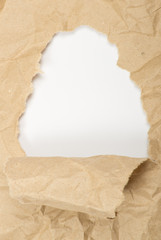 ripped white paper against a white background