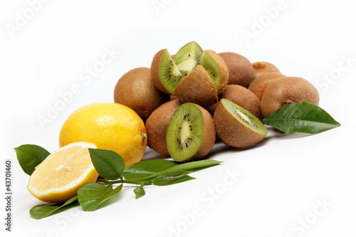 Fresh fruit. Kiwi and lemon isolated on a white background.