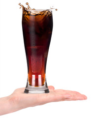 Woman hand offering fresh Cola with ice cubes