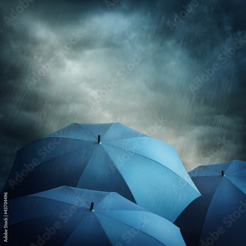 Dark clouds and umbrellas