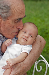 Senior Man Holding His Great-grandson