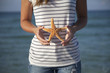 Hands holding starfish