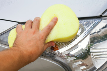 The washing of car by a sponge