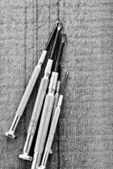 Black and White Image of Screwdrivers on wood surface