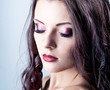 Bright purple eye evening make-up, beautiful woman portrait