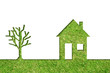 Conceptual house symbol of grass with green tree