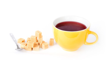 Cup of tea with a pile of sugar cubes