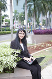Businesswoman at roadside of city