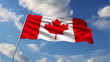 Canadian flag waving against clouds background