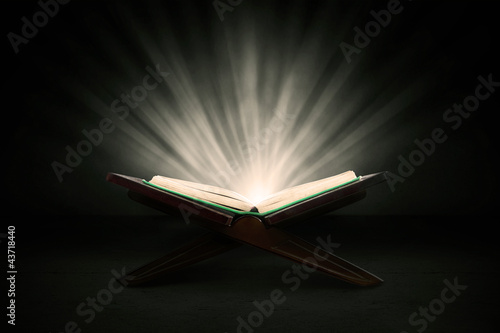 Holy quran with rays