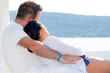 Couple in romantic hug at the sea