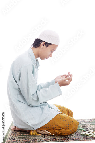 Muslim man worshiping on mat