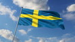 Swedish flag waving against clouds background