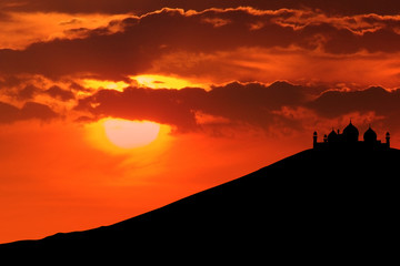 Silhouette of mosque on mountain