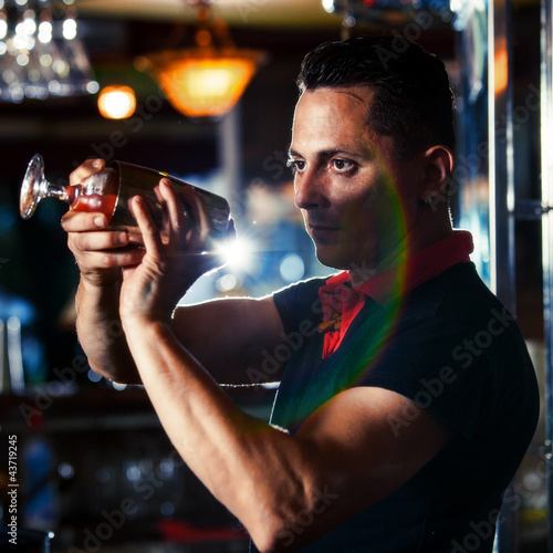 Young bartender with cocktail