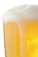 Closeup of a glass of foamy beer