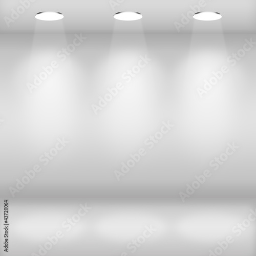 Spotlights on wall in gallery interior