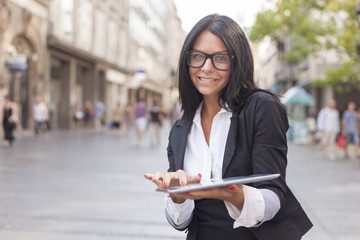 Businesswoman With Tablet Computer in city