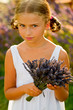 Lovely kid with bunch of lavender flowers