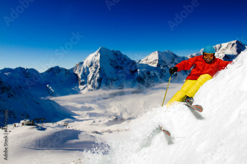 Freeride in fresh powder snow - man skiing downhill