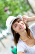 Cheerful woman with hat looking at camera