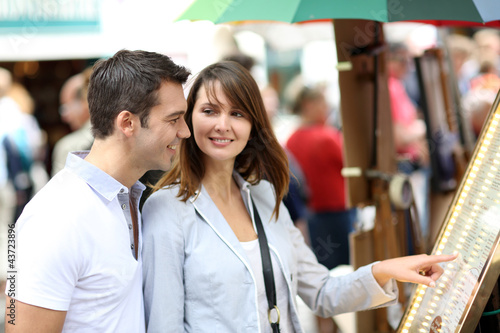 Couple in Paris looking at restaurant menu