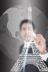 Businessman drawing Eiffel Tower line  in Paris.