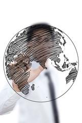 Businessman pushing World Map Globe line on the whiteboard.