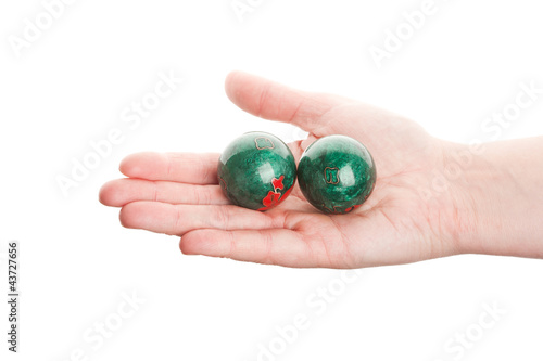Green chinese balls in hand