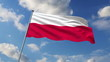 Polish flag waving against clouds background