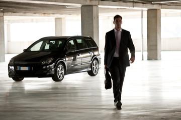 Businessman walking in underground parking