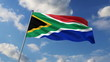 South African flag waving against clouds background