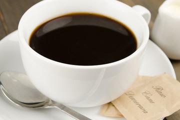 Americano black coffee, demerara sugar sachets & a jug of milk