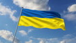 Ukrainian flag waving against clouds background