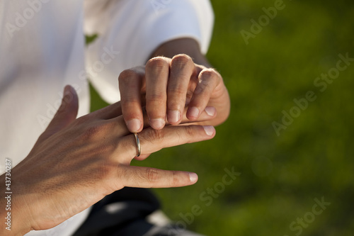 Male hands with wedding ring