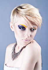 Beautiful young female with bright impudent make up