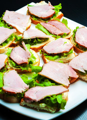Closeup of delicious ham and salad canapes