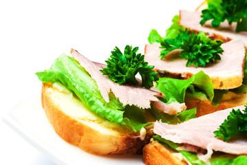 Closeup ham, salad and parsley canapes