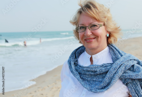 happy senior woman on summer vacation at sea