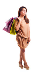 Smiling beautiful woman with shopping bags, isolated on white