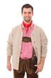 Junger Mann in Lederhose und Trachtenjacke
