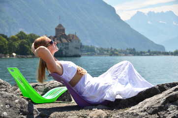 Young woman taking sunbath at Geneva lake, Switzerland